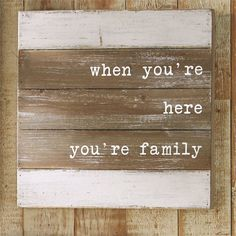 Planked natural and painted distressed wood shadow-box style plaques feature sweet family sentiments.