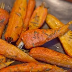 Oven-roasted carrots with rosemary are a beautiful, sophisticated, easy way to cook and serve one of the world's most popular vegetables. Oven Roasted Carrots, Cooked Carrots, A Food, Good Food, Yummy Food, Great Recipes, Favorite Recipes, Yummy Recipes, Vegetable Recipes
