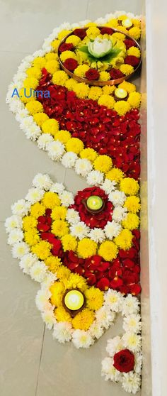 Awesome border flower design with beautiful candles for Diwali festival. Flower Rangoli Images, Simple Flower Rangoli, Rangoli Designs Flower, Rangoli Border Designs, Colorful Rangoli Designs, Rangoli Ideas, Rangoli Designs Diwali, Diwali Rangoli, Beautiful Rangoli Designs