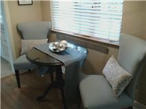 Don't you want to sit here and drink your morning coffee? That's the point of staging! Giving the buyer a peak into the life they would have living in the home.