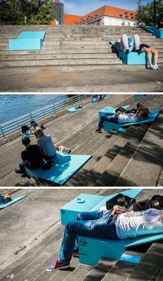 temporary installation of colorful blue seats, located on the steps next to the river in Wroclaw by Magdalena Szwajcowska and Michal Majewski of NO Studio