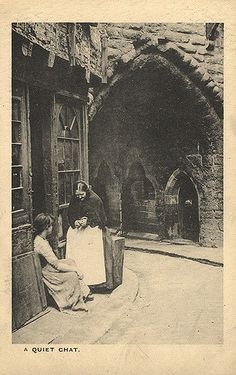 https://flic.kr/p/7ermAt   068259:Black Gate Newcastle upon Tyne Unknown Undated   Type : Photograph Medium : Print-black-and-white Description : An undated postcard of the rear of the Black Gate.  In the foreground a young woman is sitting on the door step of a shop talking to an old woman who is standing in front of her.  In the background can be seen the pointed archway of the central passage way of the Black Gate.Castles Collection : Local Studies Printed Copy : If you would like a…