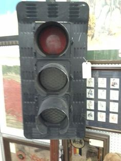 $400 - This vintage stop light, red green and yellow has new electric wiring to allow it to be plugged in. It stands on a metal base. It can be seen in booth F 20 Main Street Antique Mall 7260 East Main St ( E of Power Rd ) Mesa 85207  480 9241122open 7 days 10 till 530 Cash or charge 30 day layaway also available