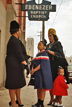 Coretta Scott King and her daughters, Yolanda and Bernice, speak with a parishioner outside Ebenezer Baptist Church in Atlanta