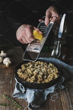 Mushroom risotto in skillet with grated cheese. Male chef grating cheese over meal in iron skillet. Mushroom Risotto, Grated Cheese, Food Photography, Stuffed Mushrooms, Meals, Baking, Skillet, Composition, Iron