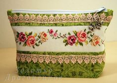 pretty cross stitch roses with lace on a small make-up bag