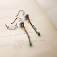 Rachel Lucie Jewellery - Inspired by the Art Nouveau design of the Paris Metro underground, I made these opulent earrings using various oxidized silver and gold fill chains with blue lace agate and a tiny emerald.