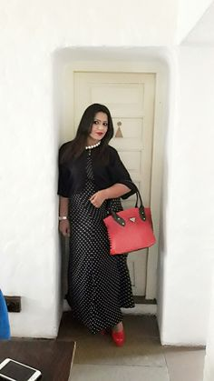 The second look is if you are not feeling too bold or dressy and are going for a family brunch or a lunch with your girls. just pair this maxi dress with a cape shrug and bag and heels in contrast. we paired up this dress with a black cape shrug and red pumps