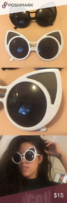 White and black oversized cat eye sunglasses Not unif but Similar to the style. Super dope alien esque sunglasses. My bf ordered my 4 of these accidentally so selling these unworn ones. Price is for both pairs. UNIF Accessories Sunglasses