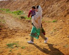 Malala Yousafzai helping a young girl across the border from Syria to Jordan. Smallah :)