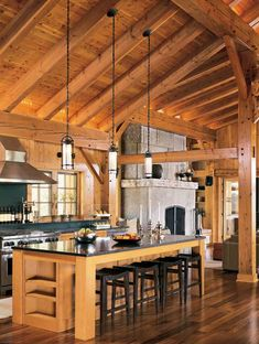 Russ: Like relationship between island and gas range. Pin note: Modern Edge: A Minnesota Timber Frame Home - Timber Home Living. Love the black counter n stools with the wood color Timber Frame Homes, Timber House, Timber Frames, Log Home Kitchens, Pole Barn Homes, Log Cabin Homes, Cabin Interiors, Beautiful Kitchens, House Design