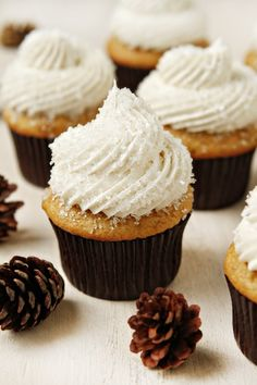 Spice cupcakes topped with vanilla buttercream and coarse sugar create a sparkling dessert that's perfect for a baby shower.
