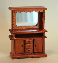 Dollhouse Miniature 1/2 Scale Mirrored Hutch. $15.00, via Etsy.