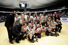 The Alemany girls basketball team poses after winning a CIF title