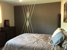 Painted wall with pattern design. Triangles or diamonds shapes was what I was going for. Argyle anyone?? Frog tape magic. Love my bedroom!