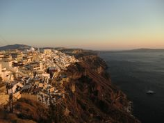 Can't get over how beautiful sunset on this island is. After a day of eating and swimming there's nothing more relaxing than watching the setting sun bathe Santorini in warm hues. More here: http://jumpedthenest.com/postcards-from-santorini/