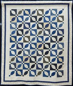 """Patty Dillon made I Guess That's Why They Call It the Blues (53 by 63""""), based on a design called Blue Garden by Minick and Simpson.  Donna Warnement quilted the quilt."""