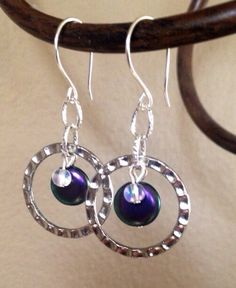 Silver hoop earrings with chain and purple Czech beads on Etsy, $15.00