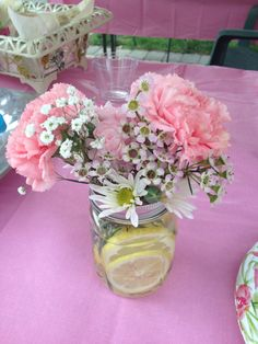 Center pieces and favors. Mason jars, flowers, fresh cut lemons. love these penies with the lemonade