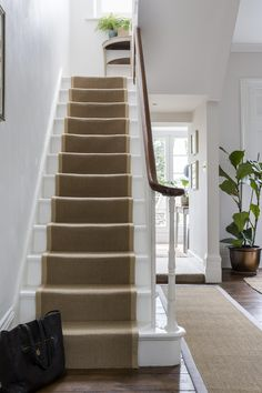 Interior Design by Imperfect Interiors at this Georgian terraced house in London. A palette of calm Farrow & Ball paint colours mixed with t. White Staircase, House Staircase, Staircase Design, Staircase With Runner, Grand Staircase, Sisal Stair Runner, Stairs With Carpet Runner, Stair Runners, Hallway Runner