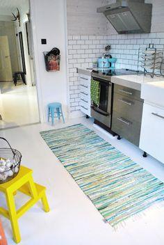 colorful rag rug in white kitchen