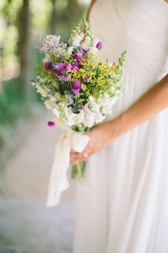 Amaranth dots with delphinium, statice and yellow wildflowers: http://www.stylemepretty.com/2015/07/08/23-gorgeous-wildflower-inspired-bouquets/