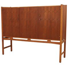 Raised sideboard by David Rosen for Nordiska Kompaniet | From a unique collection of antique and modern credenzas at https://www.1stdibs.com/furniture/storage-case-pieces/credenzas/