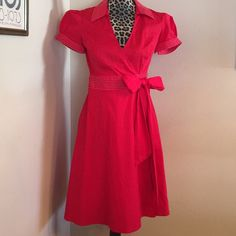 Final price drop! Rockabilly Diner Dress Excellent condition. Great Rockabilly diner-style wrap dress with circle bottom, waist tie, collar, and short bell sleeves. Bright red with white stitching. Purchased at Macy's and worn only twice. Suuuuuper cute! Speechless Dresses