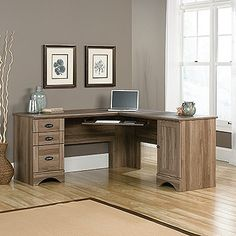 Tired of stuffy-looking L-shaped desks? This one has some character, with its stylish moldings, classy hardware, and salt oak finish. It also offers a generous