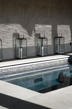 Elegant swimming pool and great use of the repeated lantern at the base of the wall.