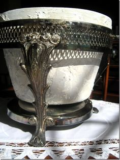 Old silverplate chaffing dish holder repurposed into a planter...love this idea!