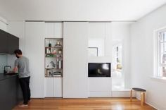 Sydney architect Brad Swartz bought a one-bedroom bachelor flat in a 1920s brick deco building in Darlinghurst last year and then set about figuring out how to adapt it so that for he and his partner it would be viable habitat, albeit within a 27-square-metre footprint.