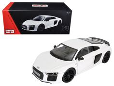 Audi R8 V10 Plus White Exclusive Edition 1/18 Diecast Model Car by Maisto - Brand new 1:18 scale diecast car model of Audi R8 V10 Plus White Exclusive Edition die cast car model by Maisto. Brand new box. Exclusive Collection Features:. Steerable front wheels that turn with the steering wheel. More coats of paint for richer colors. Unique collector's box (Closed box with foam on all sides) . Hood, doors and trunk open. Diecast metal bodies with some plastic parts. Four-wheel spring…