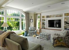 Kate Coughlin Interiors: Traditional family room with white wood beams and built-in speaker system. White ...