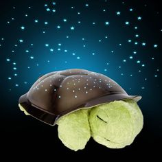 Super Awesome Baby Gift Idea.  Twilight Turtle can glow in blue, green or orange.  Stays on for 45 minutes then turns off by itself.  Splashes stars on the ceiling!
