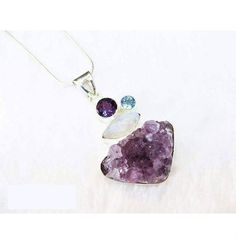Silver pendant with natural rocks : amethyst, moonstone and blue topaz Sold by Jewellry 210,00 $