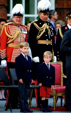 A 7-year-old Prince William and a 4-year-old Prince Harry watch the Beating Retreat Parade at The Orangery, Kensington Palace.