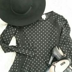 """Anthropologie knit dress Black fitted dress with A line skirt has adorable gray polka dots and black lace trim. Made of 68% polyester/31% rayon/1% spandex it can be hand washed or dry cleaned. Measures 36"""" from shoulder to hemline. Pair with black mary janes and a wool hat. Anthropologie Dresses Long Sleeve"""