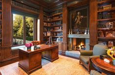 Elaborate woodwork lends itself to a luxe library and office.     Source: Chris Cortazzo