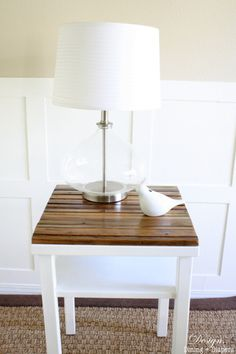 DIY Side Table Makeover With Naturally Distressed Wood.... Need to do this on our side table.... turquoise base with a black or stained-wood top