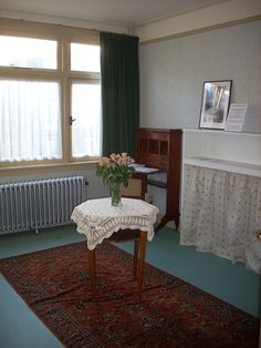 Anne and Margot's room in the the house where Anne Frank lived with her family before they had to go into hiding.   Merwedeplein in Amsterdam.  The rooms have been restored and decorated in the style it had when the Franks lived there.
