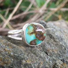 Turquoise Ring, Size 9 1/2, Sterling Silver  This teal turquoise stone with large fields of brown matrix is accentuated with a simple fine