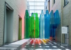 Kéré Architecture suspends colourful strings from ceiling of Philadelphia art museum