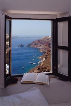 """City of Santorini in Greece. Santorini was formed by a series of volcanic eruptions. The island was once known as Stongili, which means """"round"""" in Greek. Places To Travel, Places To See, Beautiful World, Beautiful Places, Amazing Places, Haus Am See, Window View, Open Window, Through The Window"""