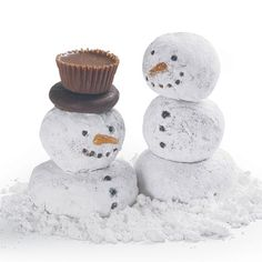 Doughnut Snowmen  mini powdered donuts and donut holes. cranberry on bottom to hold donuts and small skewer.  peppermint patty and mini peanut butter cup for hat. mini choice. chips for face.