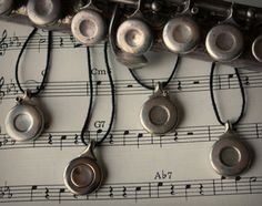 flute key silver circle pendants! Yay! recycled musical instrument jewelry!