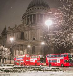 Icy blast: Arguably London's greatest building, St Paul's Cathedral, is covered in snow this morning as the capital is hit with snow #amazingdestinations