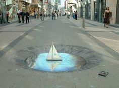 Julian Beever pavement art. The water astounds me.