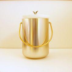 Kromex Ice Bucket, Mid Century Barware, Gold Spun Aluminum, Chrome Lid. $25.50, via Etsy.