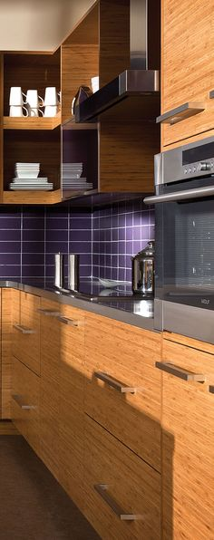 This Bamboo Kitchen Design uses stainless steel appliances and hood for a contemporary look - Dura Supreme Cabinetry
